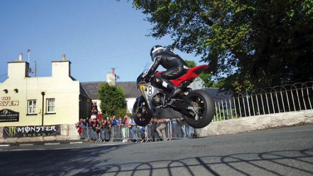 Guy Martin gets some crazy air time as he races at the IOMTT Isle of White Tourist Trophy Motorcycle Race