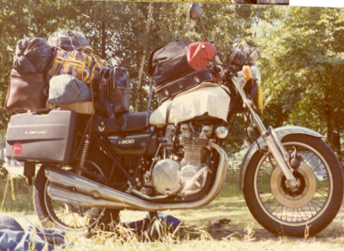 a vintage photo of an old bike packed and ready to tour. american motorcycle touring at its best.