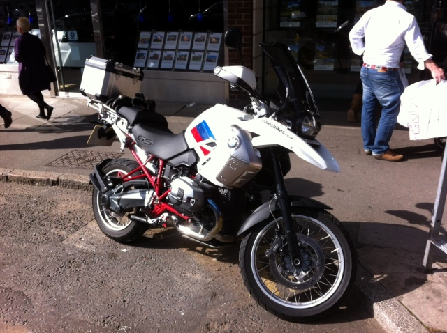 test riding a white, red and blue BMW 1200 GS Rallye